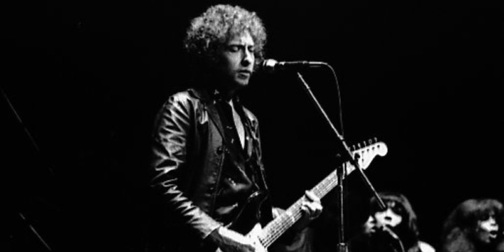 Bob Dylan performs at Massey Hall, in Toronto, Canada, April 18, 1980. Photo: Jean-Luc Ourlin via Wikimedia Commons.
